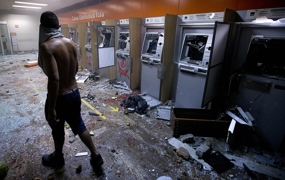 Destroying a bank achieves what exactly? (AP Photo/Victor R. Caivano)